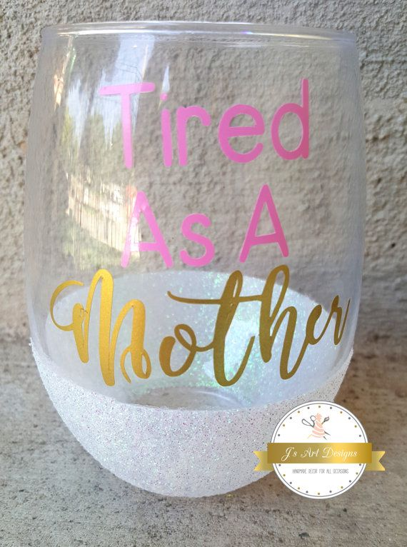 "Beautiful Glitter dipped Wine Glass in Iridescent glitter. Perect for all you tired mommas. You deserve a glass of wine! Comes in any color you choose. Saying is ""Tired as a mother"""