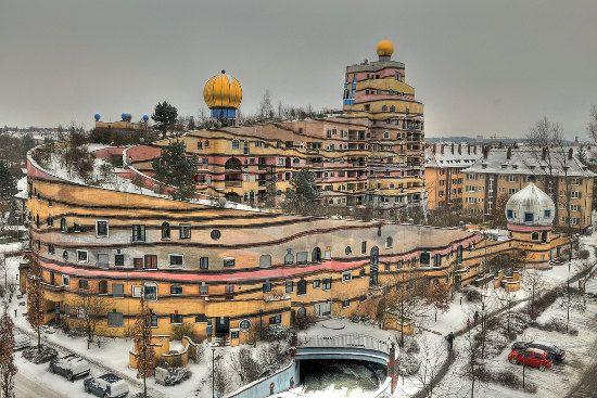 """Forest Spiral, Darmstadt:   Designed by Austrian architect Friedensreich Hundertwasser, the """"Waldspirale"""" features 105 apartments wrapped around a courtyard landscaped around a running stream and with a restaurant and cocktail bar in the turret."""