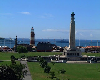 Plymouth Hoe....Smeaton's Tower Lighthouse, War Memorial with Plymouth Sound in distance. Plymouth, Devon, England,