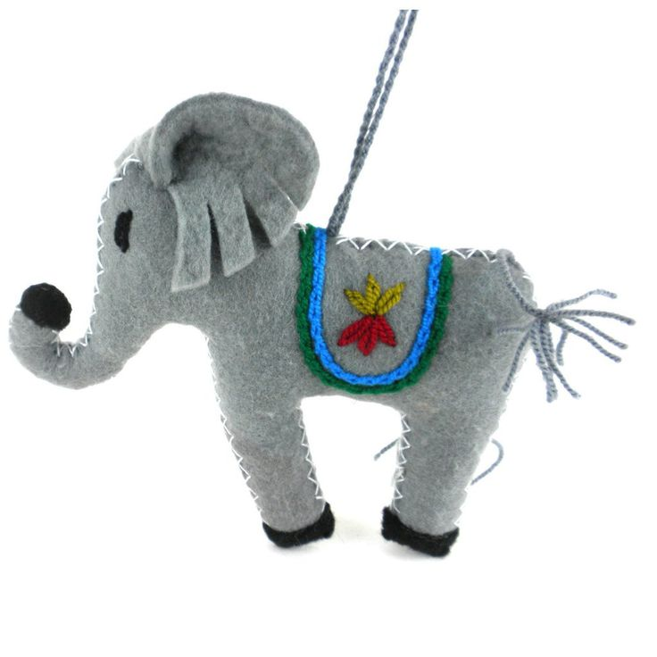 Elephant Fair Trade Felt Tree Ornament. The majestic elephant rounds out any beautiful holiday tree!    Women in Kyrgyzstan made this ornament by hand from felt. With a loop for hanging, this piece measures 4.5 inches long. Meet the Artisans      Silk Road Bazaar is a wholesale representative of marginalized artist groups located in Kyrgyzstan and throughout Central Asia. They connect with artists who are far from the capitals, who have limited market access, or who do not possess...