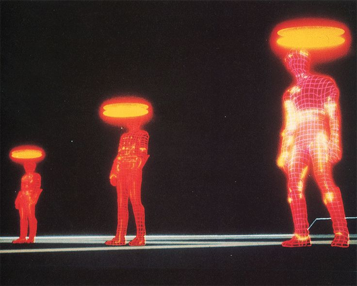 A still from Tron (Disney 1982). Three video game warriors poised to transform in 'Light Cycles', the glowing red lines added optically over the top of the actors – I presume this means 'in post-production'.