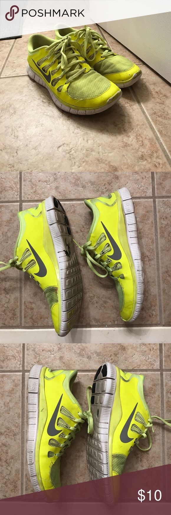 Neon yellow Nike Frees 8.5 Used Nike Frees in neon yellow. Used these as running shoes. See wear in photos Nike Shoes Sneakers