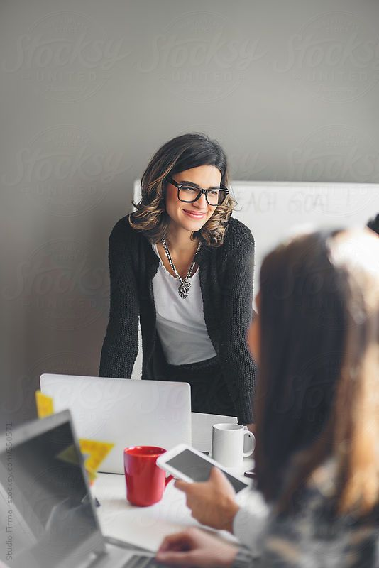 Businesswoman in a Meeting. by dijanato | Stocksy United