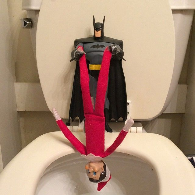 Batman holding Elf on the Shelf over the Party by WV Mom on Instagram