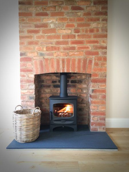 Charnwood C-Five riven slate hearth brick fireplace.jpg