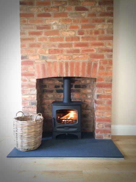 Charnwood C-Five riven slate hearth brick fireplace.jpg