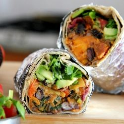 Spicy sweet potato and black bean burritos with avocado and salsa.