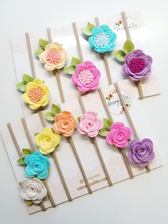 A FLOWER RAIN-BOW... Set of 5 gorgeous rosettes made with wool felt in pastel rainbow colors on a high-quality nylon headband, (it wont rash easily)... So soft and comfy for your little girl... Ideal for the everyday outfit...  Your princess will have a bow to match every outfit...