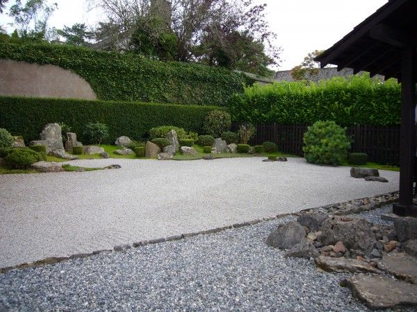 zen garden. I'm not usually interested in gravel expanses, but I like the mixed border along the wall and some of the stonework in the foreground.