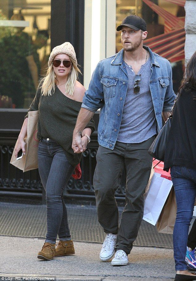 Hold my hand! Hilary Duff was spotted with rumored boyfriend Jason Walsh as the two walked...