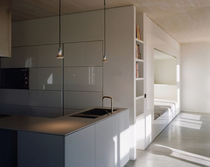 White wall.., contrasting floor and ceilings...