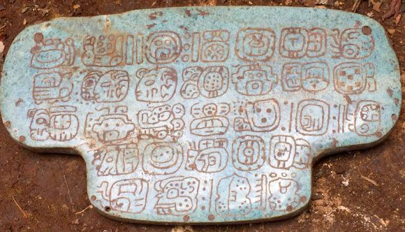 The Maya jade pendant is inscribed with 30 hieroglyphs. The jade stone itself is from the mountains of Guatemala, southwest of Belize. Image credit: Geoffrey Braswell, University of California, San Diego.