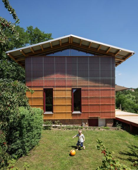 Corrugated plastic cladding reveals the timber structure of this house by Czech…