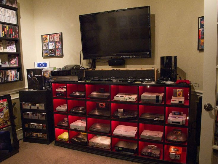 absolutely amazing custom setup with back lighting containing every gaming system in their individual