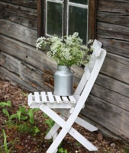 Timber, texture, - love the flowers and the container place on the painted white chair.......