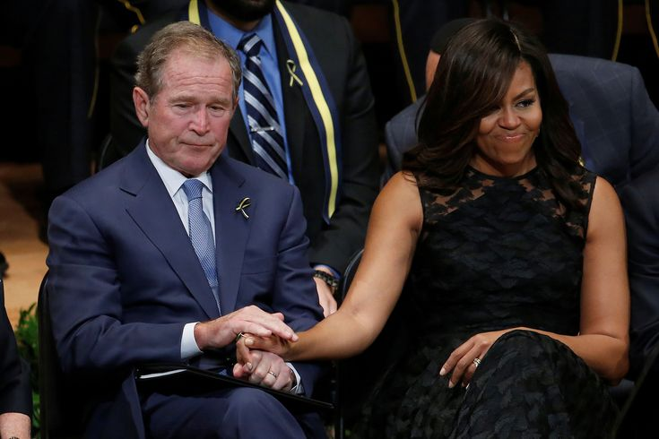 Former President George W. Bush (L) holds hands with first lady Michelle Obama during a memorial service following the multiple police shootings in Dallas, Texas, U.S., July 12, 2016.  REUTERS/Carlo Allegri via @AOL_Lifestyle Read more: https://www.aol.com/article/news/2016/07/13/george-w-bush-turns-heads-at-dallas-funeral-with-dance-moves/21431217/?a_dgi=aolshare_pinterest#slide=3986165