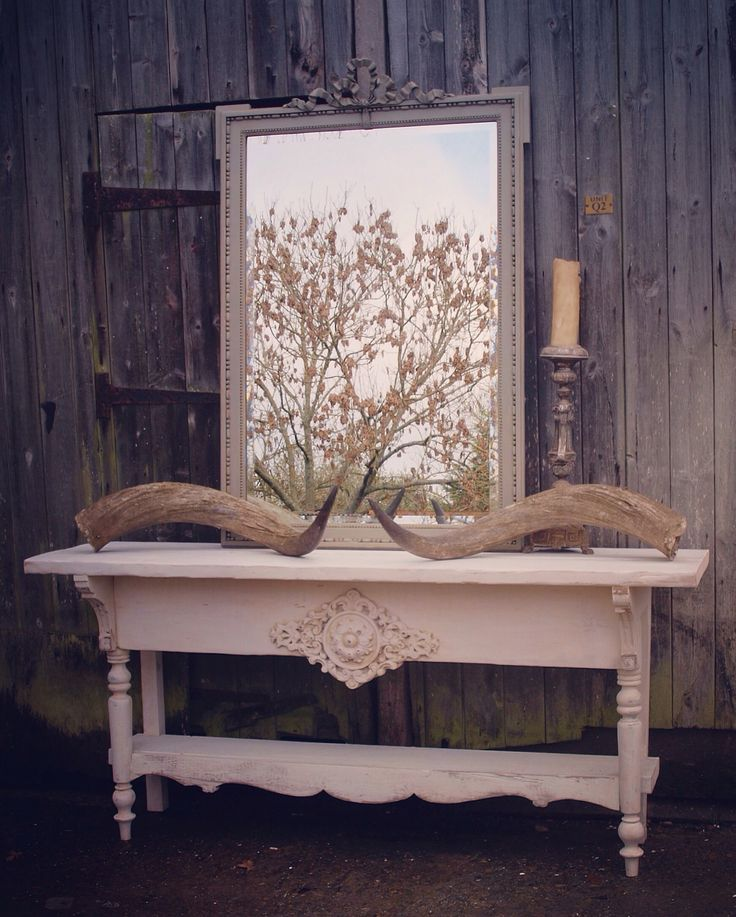 MothInteriors Table with reclaimed wood and 19th century French carvings @mothinteriors.com  £350-£450