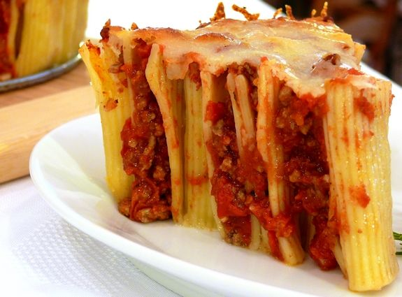 Pasta Pie.  My grandma used to stuff rigatoni with her homemade meatballs that she had crushed with a fork.  The rigatoni was raw...she coated the stuffed pasta with her homemade sauce and covered with parmesan cheese.  Baked it for about 45 to 50 minutes.  It was yummy.  This looks like a faster way.