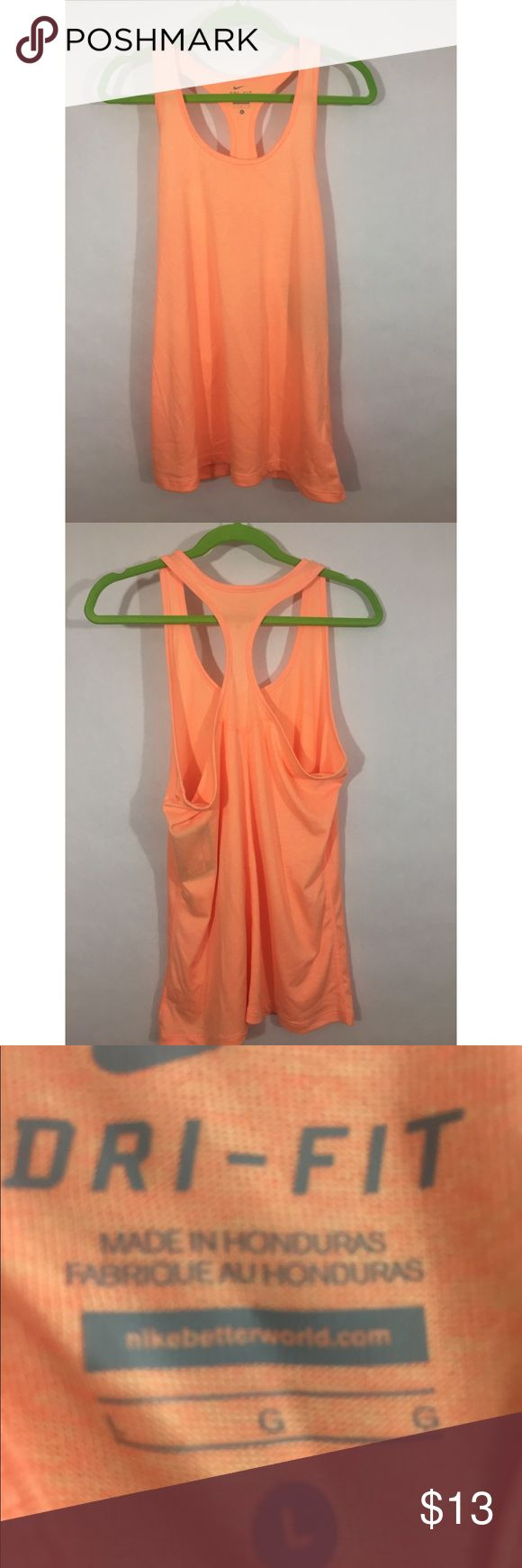"NWT Nike balance dri-fit tank New with tags Nike dri-fit balance tank in peach. Size large. 100% polyester. Racer back. Retail $25. Bust 19.5"", length 28"". Nike Tops Tank Tops"