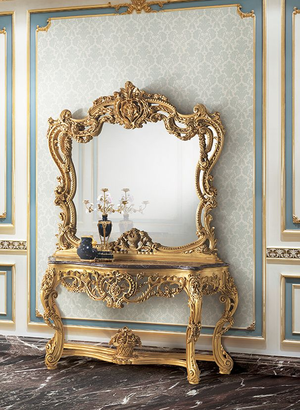 Carved console and frame with mirror