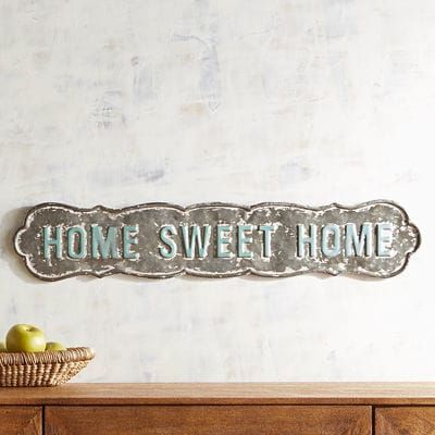 With a touching sentiment that your house is your home, our wrought iron wall decor is ready to come home with you and just hang. Sweet.
