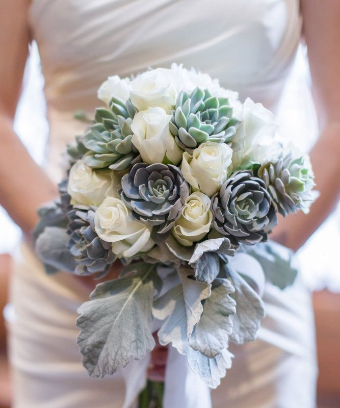 This icy toned succulent bouquet would fit in perfectly if you're tying the knot at a winter wedding venue