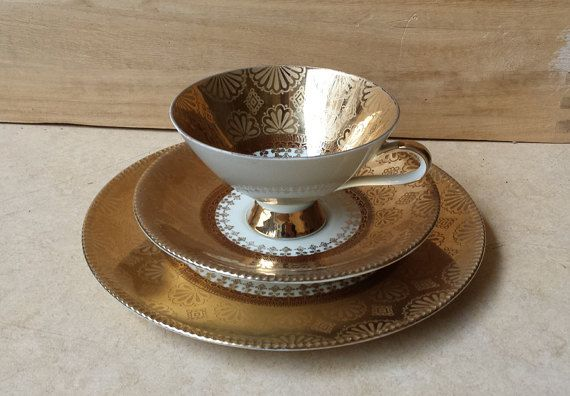 Superb trio cup, saucer and plate from the 1950s by Winterling, Marktleuthen, Bavaria, Germany. Intricate floral and abstract patterns in gold. Excellent condtition, few handling traces Bottom markings (green stamp): Winterling, Marktleuthen, Bavaria. Höhe/Height: 7 cm. (stacked) Ø: