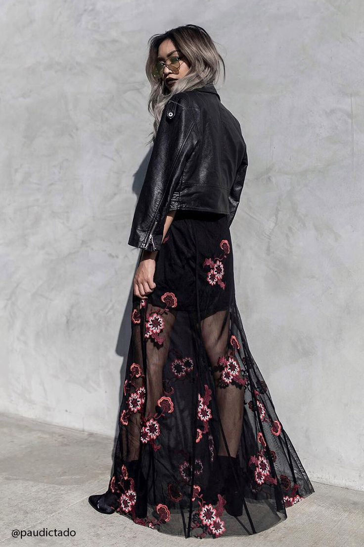 A maxi skirt featuring a mesh overlayer with floral embroidery, inverted pleats on front and back, a knit underlayer, and a concealed side zipper with hook-eye closure.