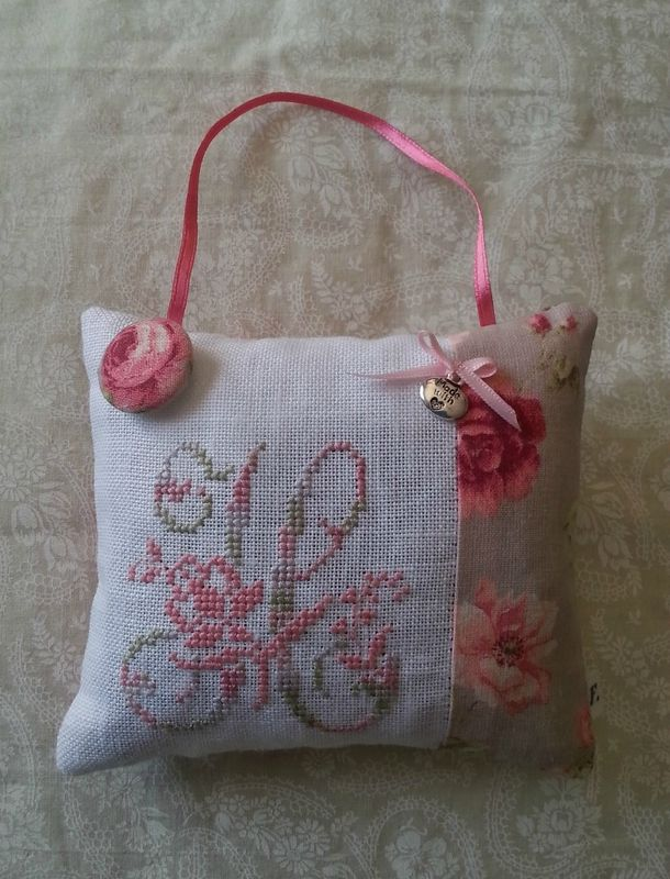 Cute little cross stitched initial puff. Could add lavender inside.