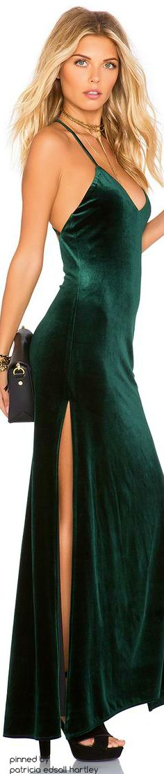 Redheads know that a classy black velvet dress will not only open doors for them but will get the doors held for them as they pass through.  However green velvet is sometimes even more stunning on a redhead.