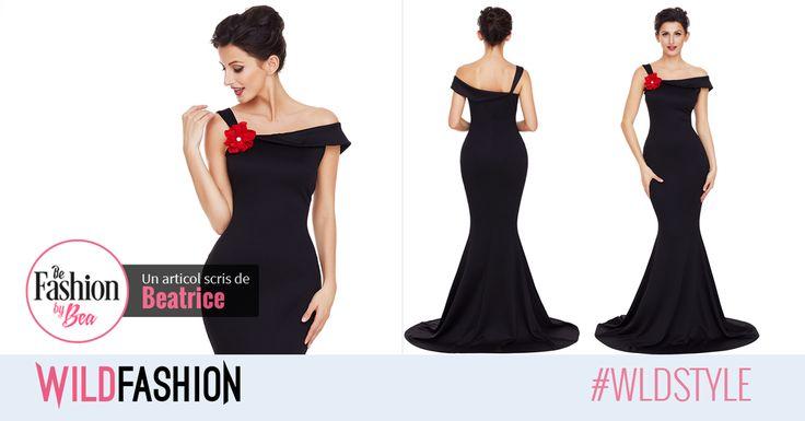 Vrei sa te simti ca o diva la urmatorul eveniment? Atunci aceasta rochie neagra cu detaliu floral si un model deosebit este cea mai buna alegere: