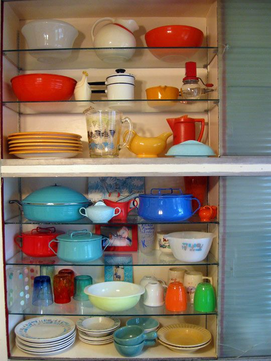more open shelves and awesome dishes...I think it's the same collection re-arranged