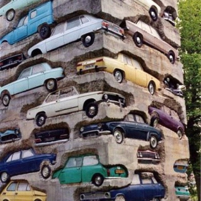 Concrete wall of junk salvaged cars, recycled art; Upcycle, Recycle, Salvage, diy, thrift, flea, repurpose!  For vintage ideas and goods shop at Estate ReSale & ReDesign, Bonita Springs, FL  http://www.metalrecyclers-brisbane.com.au/
