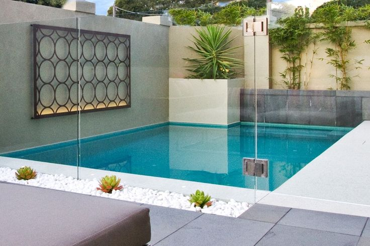 Laser cut decorative metal screen by the pool. Image courtesy of Baden Pools