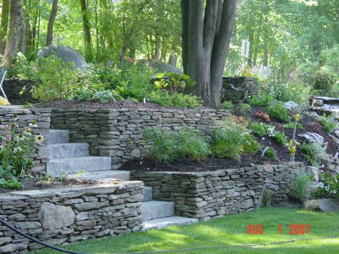 Using stacked stone for retaining walls allows use of larger stone within the wall to add design appeal.