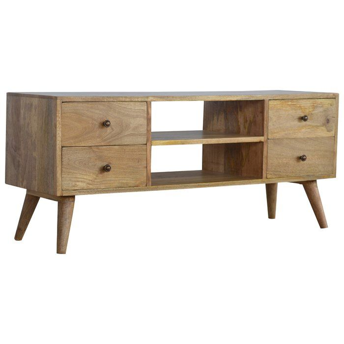This Nordic-inspired Solid Wood TV Stand media unit will freshen up your living room, with its beautiful clean design. Useful storage space is available with 2 drawers, decent sized table top to place your TV and a backless shelf in the middle to place your cable boxes. Also, this media unit is constructed from 100% solid mango wood and has a fine oakish finish. Other features include 4 Scandinavian styled legs and shiny brass knobs for the 2 drawers.