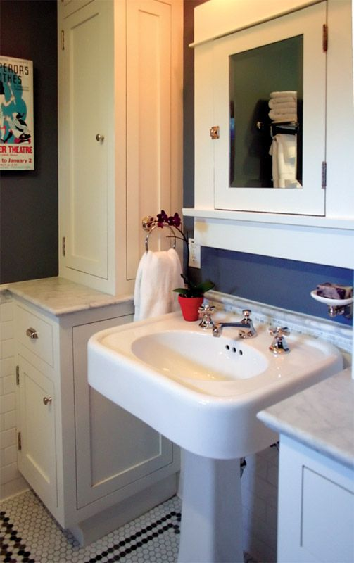 Strategically placed built-ins and a salvaged pedestal sink helped deliver more space to the small master bathroom.