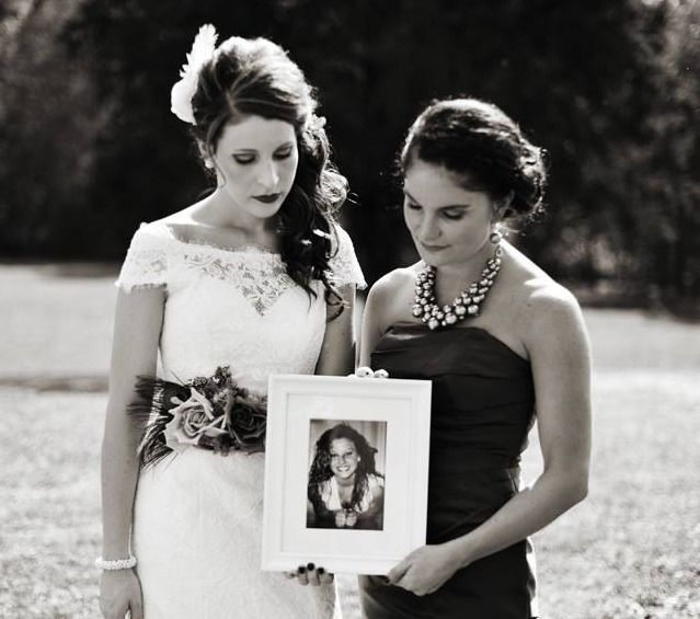 A way for us to honor a dear friend who we lost to a car crash many years ago. One of the most important pictures from my wedding. Don't be afraid to incorporate lost loved ones into your ceremony. We had a vase of pink flowers that my little brother placed at the end of where the bridesmaids stood to recognize that she was a bridesmaid in spirit.