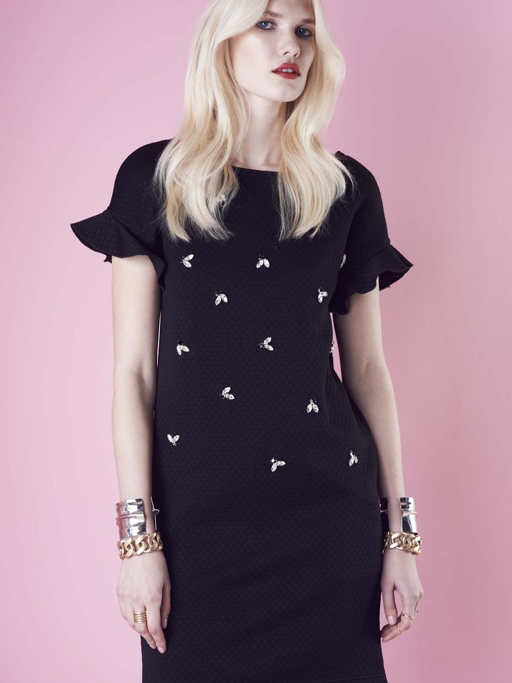 Model wears Naughty Dog black quilted #dress decorated with hand-sewn Swarovski crystals.