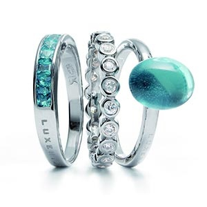 Gorgeous teal and diamond rings