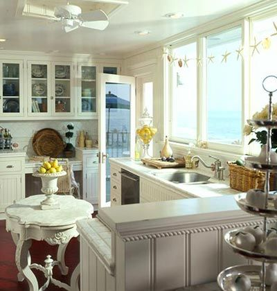 cream colored kitchen~~Love the little table and the urn with lemons!