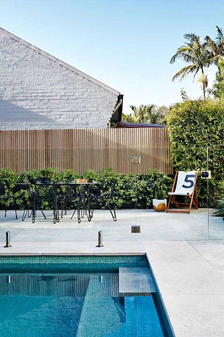 use cement style tiles for a modern pool deck