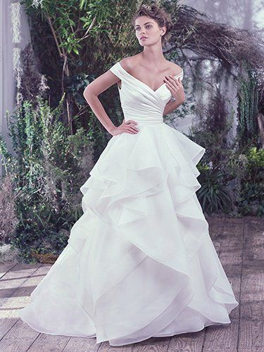 Maggie Sottero - zulani, This off-the-shoulder wedding dress features an asymmetrically pleated L'Amour satin bodice atop a sculptured Venice organza ball gown skirt trimmed in horsehair. Off-the-shoulder sleeves create a portrait neckline flaunting an exquisitely romantic style. Finished with covered buttons over zipper closure.