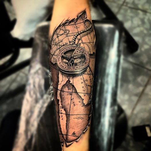 Ripped Skin Map With Compass Tattoo On Forearm. Love the ripped edges.