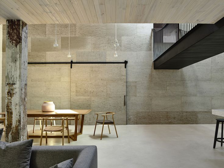 Fitzroy Loft is a minimal residence located inside a 125 years old chocolate factory in Melbourne, Australia, designed by Architects EAT.