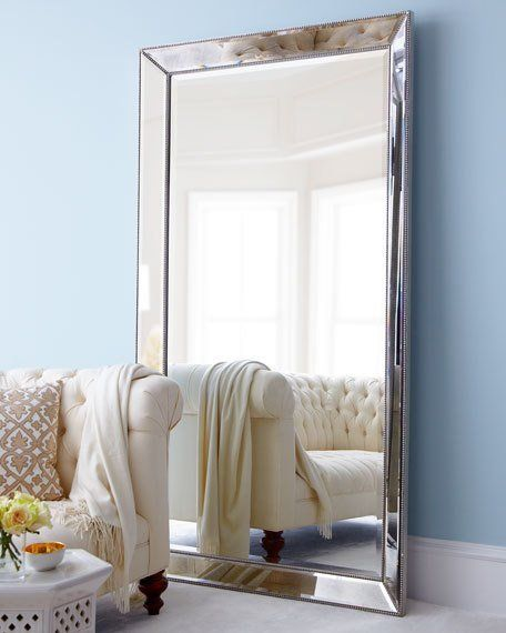 "Mirror-framed mirror. Frame is antiqued; mirror is beveled. Antiqued-silver beaded trim. 44""W x 4""D x 79""T. Imported. Boxed weight, approximately 120.6 lbs."