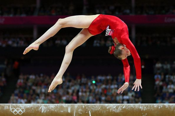 Loving the red leotards, they look simple, strong yet feminine. Olympics Day 2 - Gymnastics - Artistic