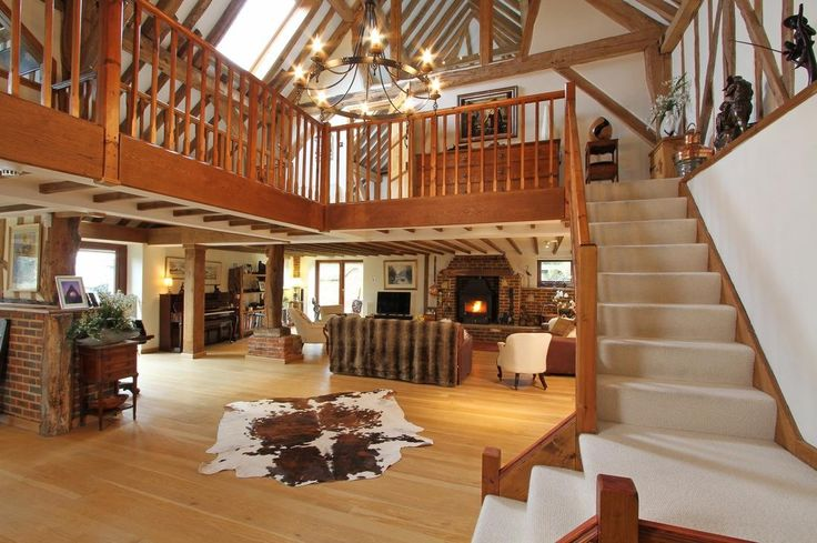 Barn conversion with lots of exposed timber wood such as oak, pine, birch & beech.