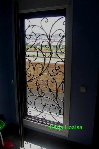Forja loaisa puerta de hierro interior puertas de hierro - Puertas de hierro ...