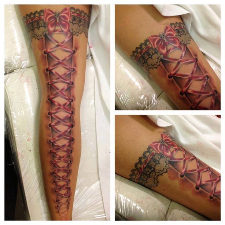 Leg tattoo. Lace up boot look. Kinda cool.